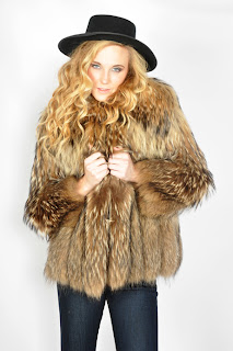Vintage 1970's fluffy brown coyote fur bomber jacket.