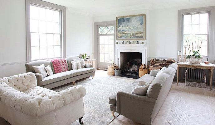 Living Room With Herringbone Wood Floor Dueling Sofas A White Upholstered Sofa Nail