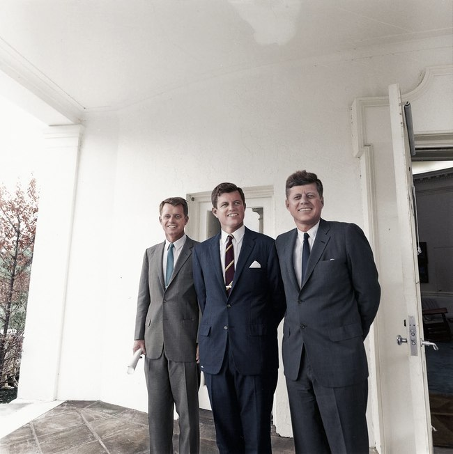 Brothers Robert Kennedy, Edward 'Ted' Kennedy, and John F. Kennedy outside the Oval Office.