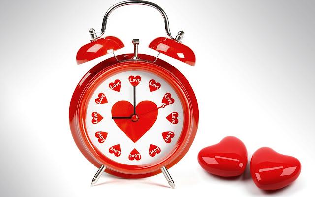 Afbeelding wekker met rode hartje