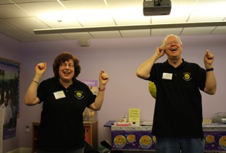 Linda and Bill leading a laughter yoga session