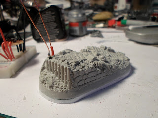 Dragon Forge's Heroic Urban Rubble base with wires in it to power an LED