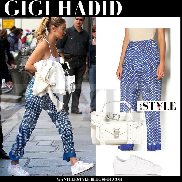 Gigi Hadid in blue polka dot print silk anna sui pants, white adidas sneakers with white bag what she wore models off duty