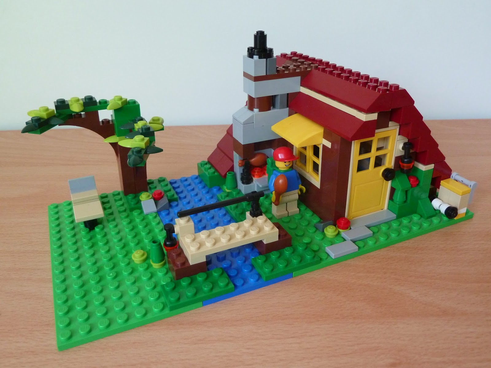 Superb img of LEGO 5766 LEGO CREATOR 3 IN 1 Log Cabin River Hut Deuxième modèle (2  with #168337 color and 1600x1200 pixels