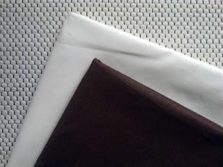 Yksiväriset vaalea ja ruskea kangas