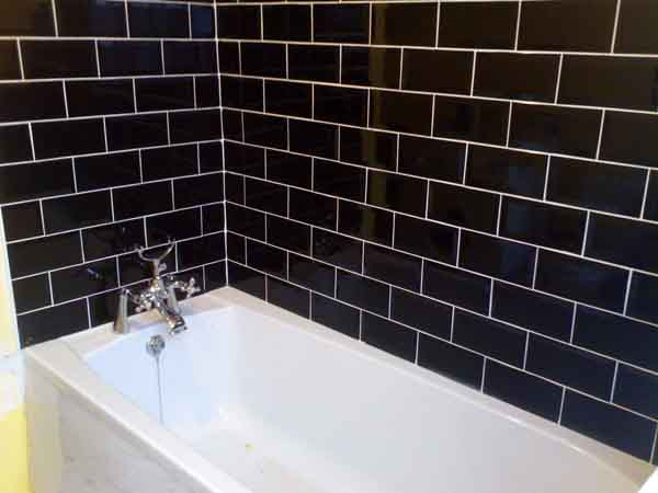 Grout color for black glass subway tiles for Black tile bathroom designs