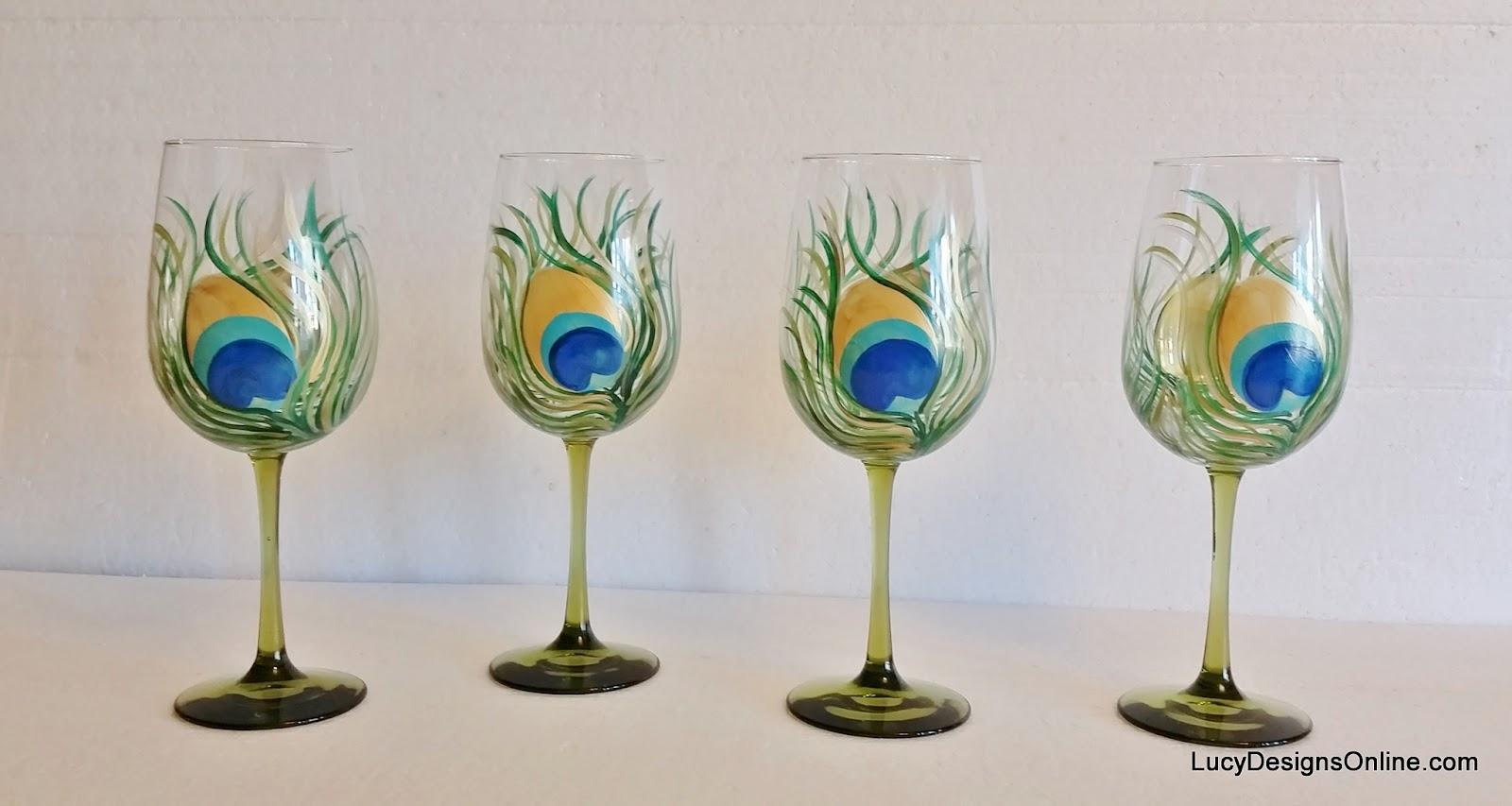 hand painted peacock feather wine glasses Lucy Designs
