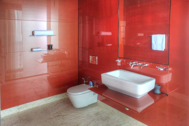 Red wall modern bathroom