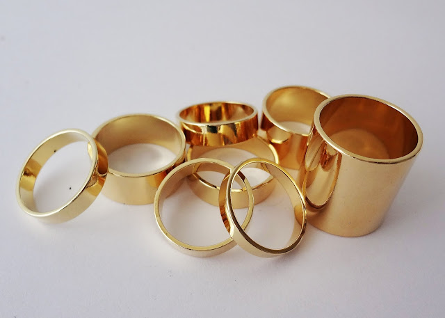 ASOS Pack of 8 Smooth Rings in gold.