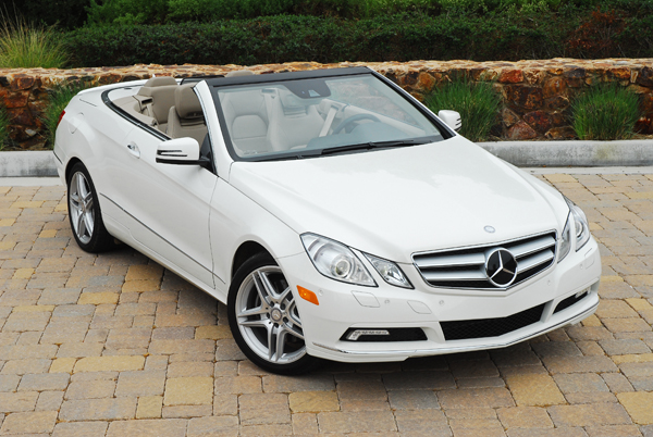 Front 3/4 view of white 2011 Mercedes-Benz E350 Cabriolet parked with top down