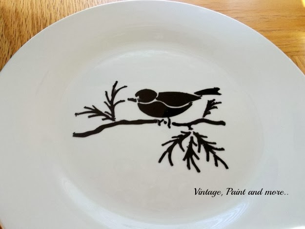 The bird stencil completed on the plate