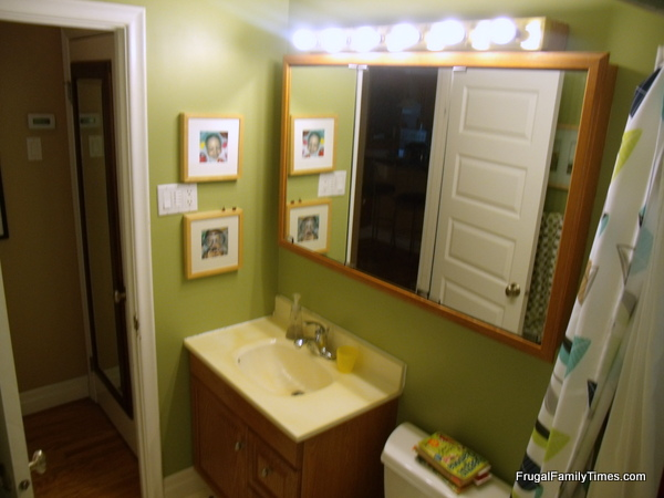 Bathroom Vanity Lights Over Medicine Cabinet how to update an old dated medicine cabinet on a tight budget