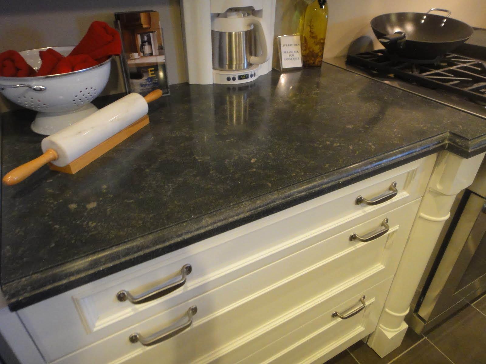 Concrete Countertops with Antique White Cabinets
