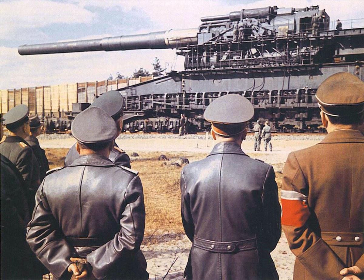 Hitler and generals inspecting the largest-caliber rifled weapon ever used in combat, 1941
