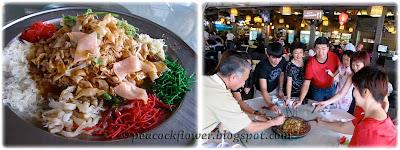 Enjoying a plate of Salmon Yee Sang