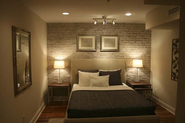 Exposed brick and plaster walls for the interior design of for Interior brick wall designs