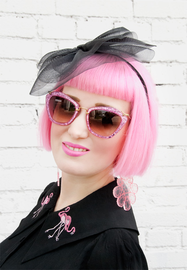 Miu Miu glitter sunglasses, fascinator, pink hair