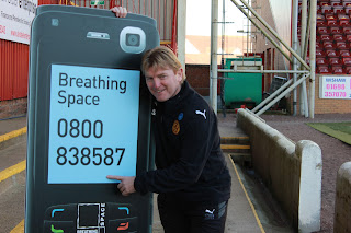 NHS Breathing space helpline mobile phone prop