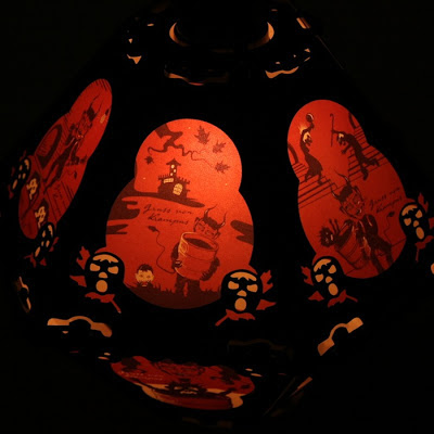 This 12 side lantern by Bindlegrim offers art in red, black, white illustration of Europe Christmas tradition the Krampus