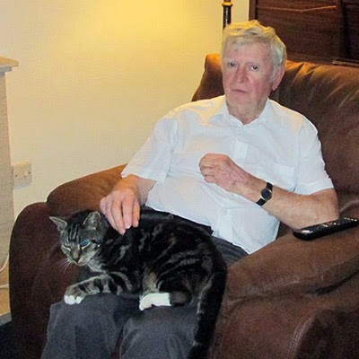 Elderly cat and owner