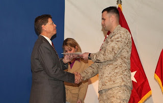 Marine Cpl. Yevgeniy Levin receives his Certificate of Naturalization from Robert Looney, USCIS Bangkok District Director during a naturalization ceremony on Kandahar Airfield in Afghanistan on Jan. 29. (Photo courtesy of the U.S. Marine Corp)