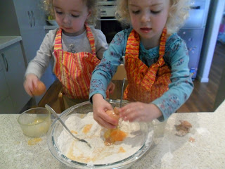 Adding wet ingredients to dry ingredients for rainbow cake.