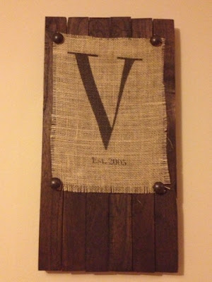 http://twoityourself.blogspot.com/2013/08/diy-wood-panel-and-burlap-monogram.html