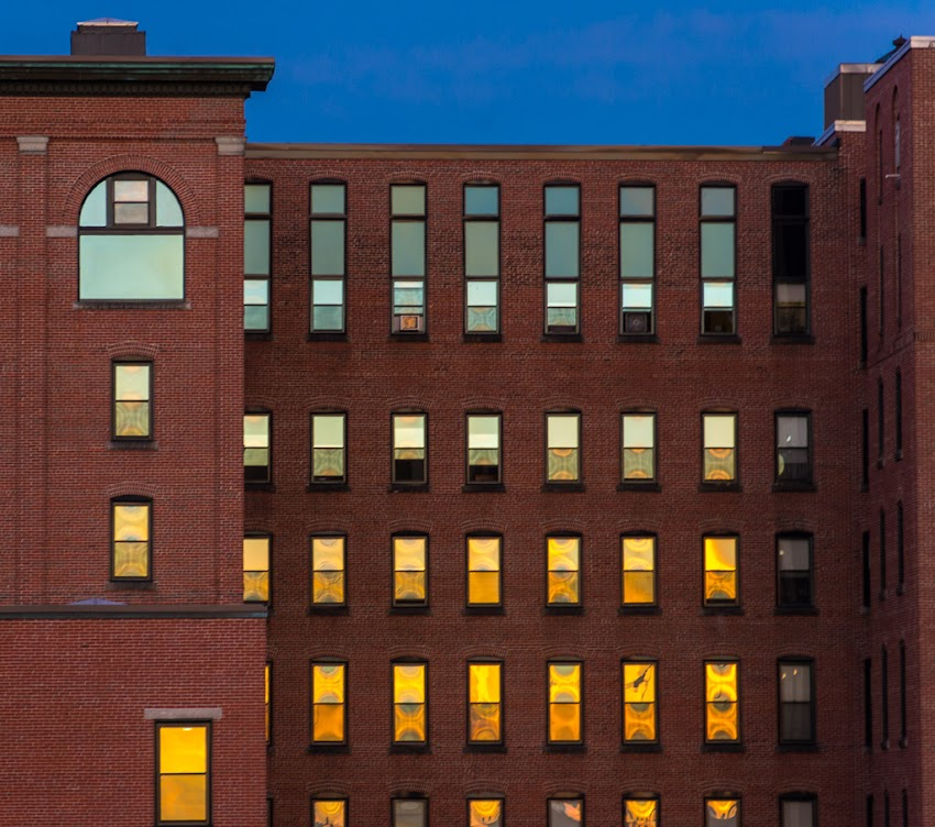Sunset reflected in windows of old brick building in Portland, Maine USA June 2015 photo by Corey Templeton.