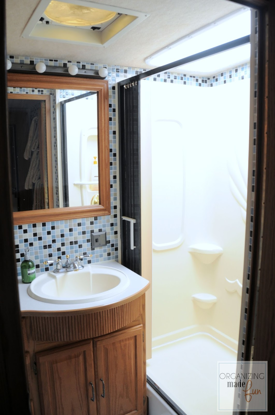 Luxury Updated RV bathroom with tile and shower painted in oil rubbed bronze OrganizingMadeFun