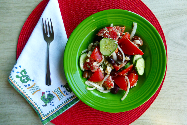 Greek Salad, tomatoes, cucumber, onion, feta chese, kalamata olives, olive oil, fiestaware