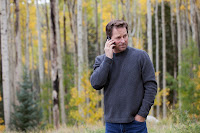 Man on a cellphone in a forest