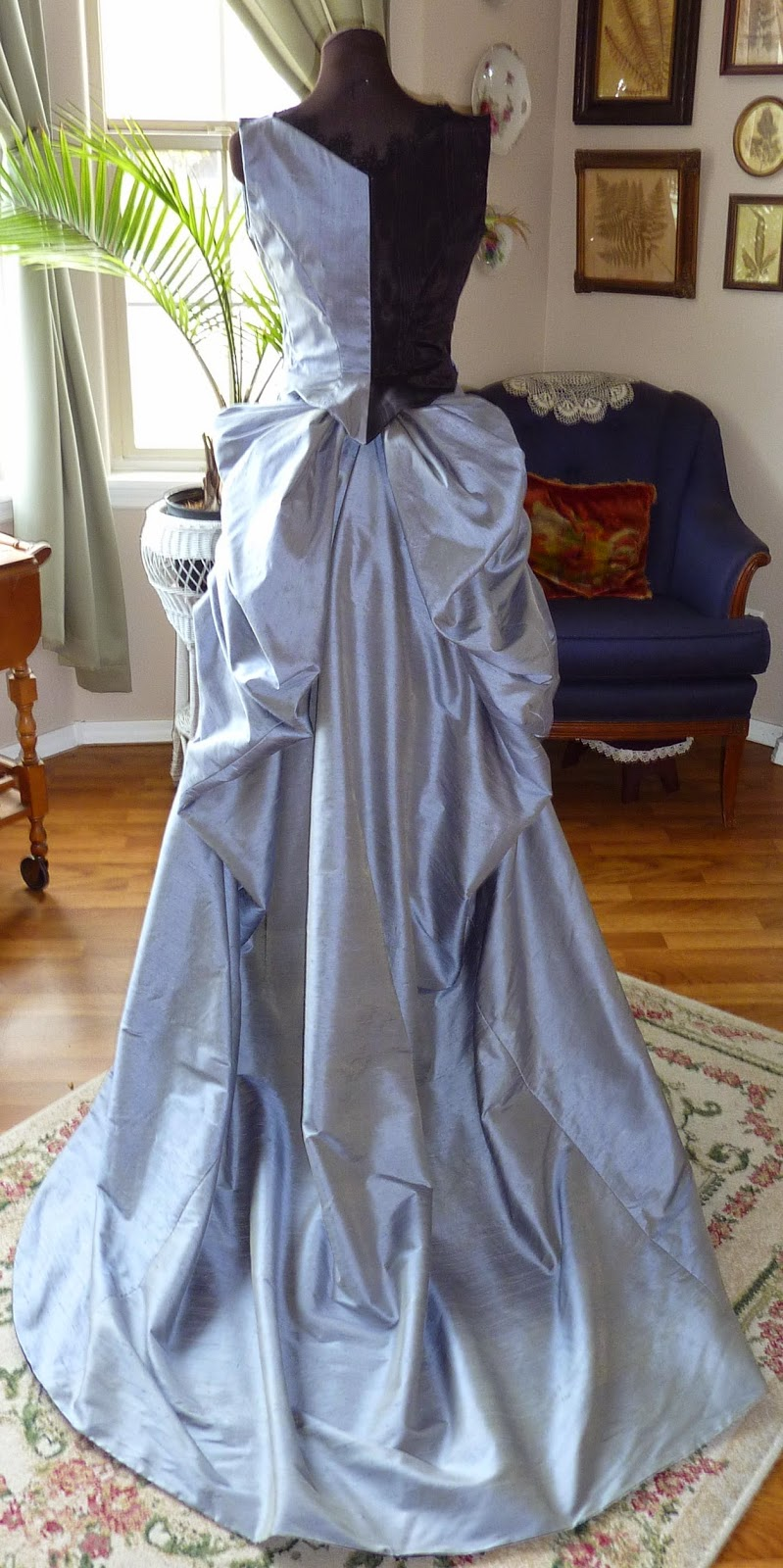 Beauty From Ashes: 1885 Black and Blue Ball Gown