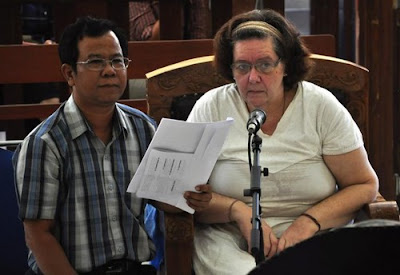 Lindsay June Sandiford, accompanied by her translator listens to the prosecutors during her second trial in Bali in October 4, 2012.