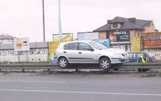 Funny pictures: Car lands on guardrail