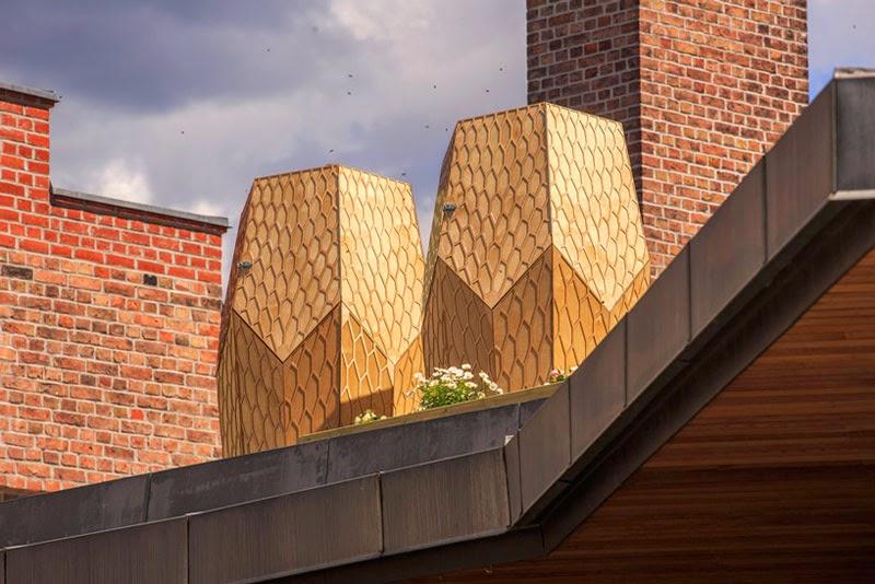 Snøhetta crea las colmenas de madera Vulkan Beehive