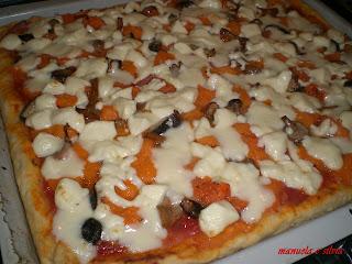 pizza bio ai pomodori secchi farcita con zucca e misto funghi