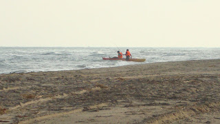 Canoe men - El Serrallo beach