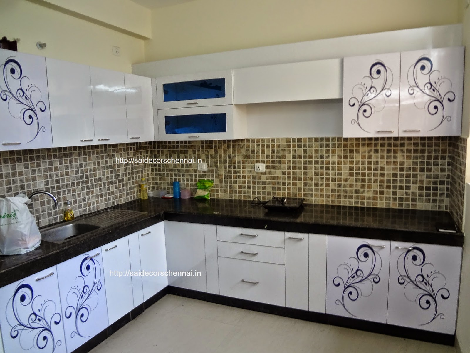 Flower  Floral Design Modular Kitchen With Customized Creeper Design Glossy  Or Matt Finish With Soft Close Hinges.