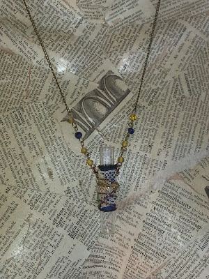 recycled glass vial, fibers, and beads make a great necklace