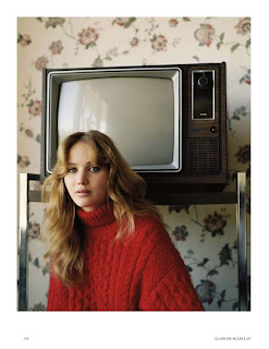 Jennifer Lawrence in a red turtle neck sweater