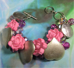 Glamorous bracelet has silver heart buttons and clusters of shiny pink beads