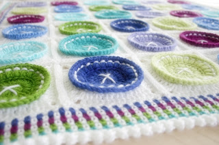 Bright as a Button Blanket Crochet Pattern by Susan Carlson of Felted Button