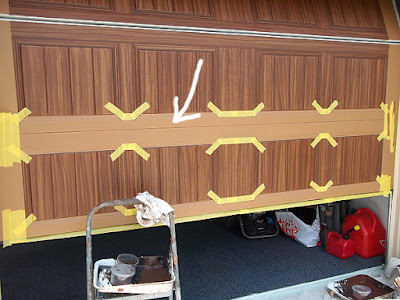 garage door painted to look like wood