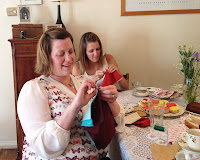 hens sewing purses during the craft workshop