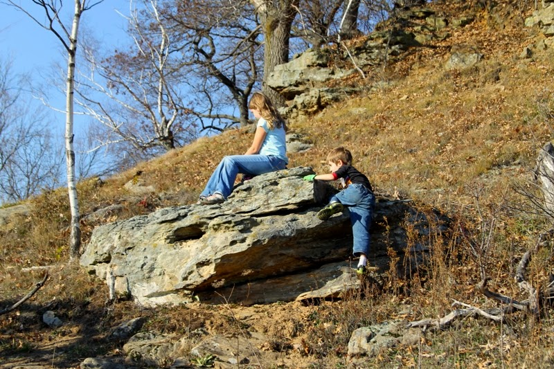 a rock, a hill, sunshine.  what more could a kid ask for?