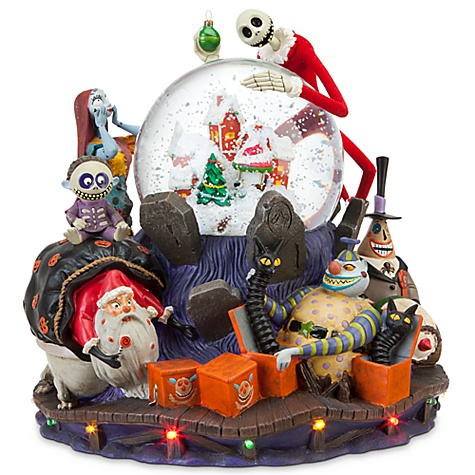 it is pretty much the same but apparently has some paint variations such as the ornament in jacks hand and jacks coat has red velvet flocking - Nightmare Before Christmas Snow Globes