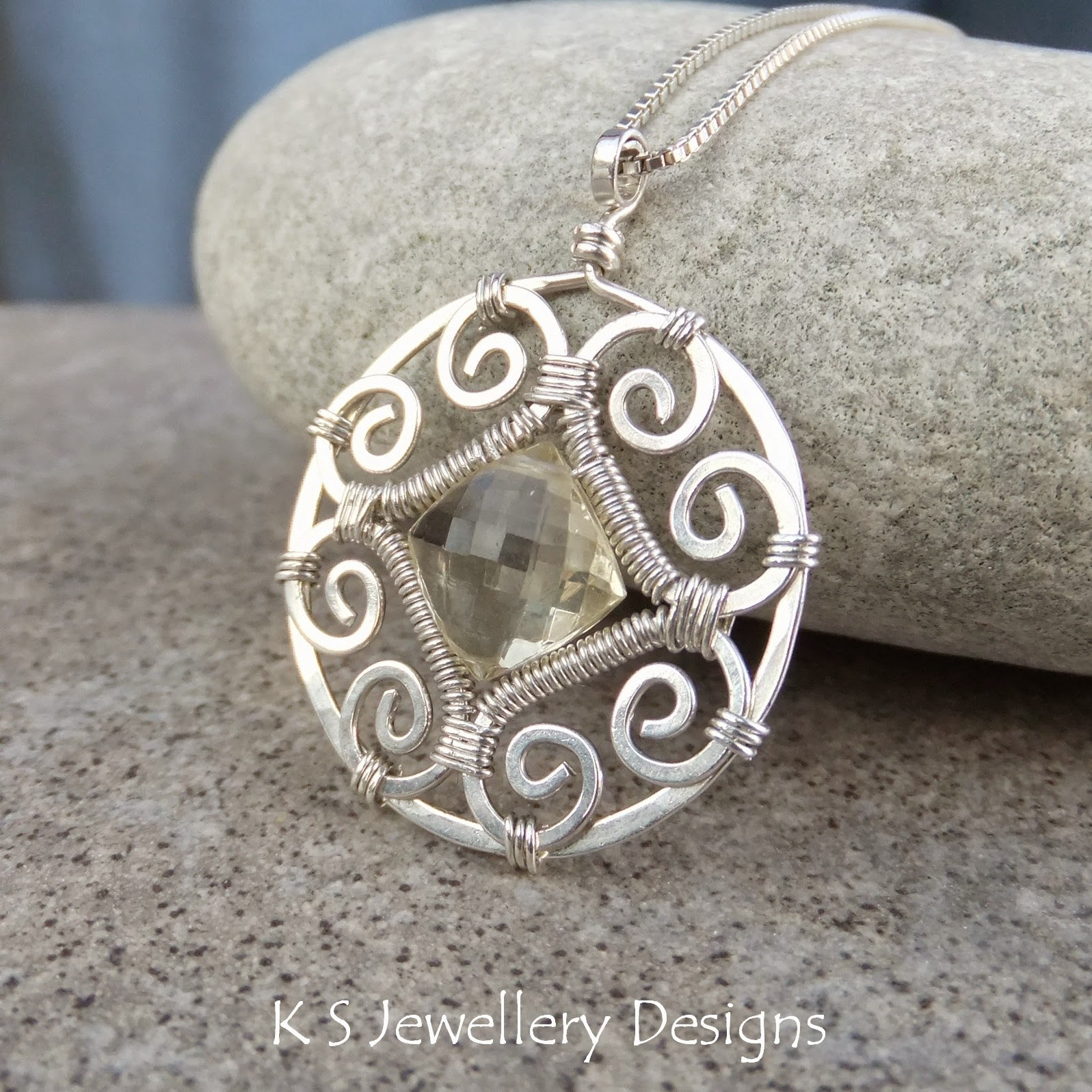 http://ksjewellerydesigns.co.uk/ourshop/prod_2922948-Scapolite-Sterling-Silver-Circle-Frame-Pendant-Necklace.html