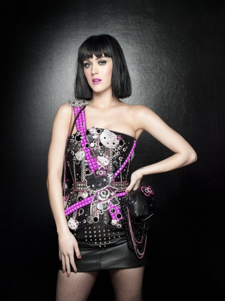 Katy Perry black bob hair and style hello kitty punk black and purple outfit.