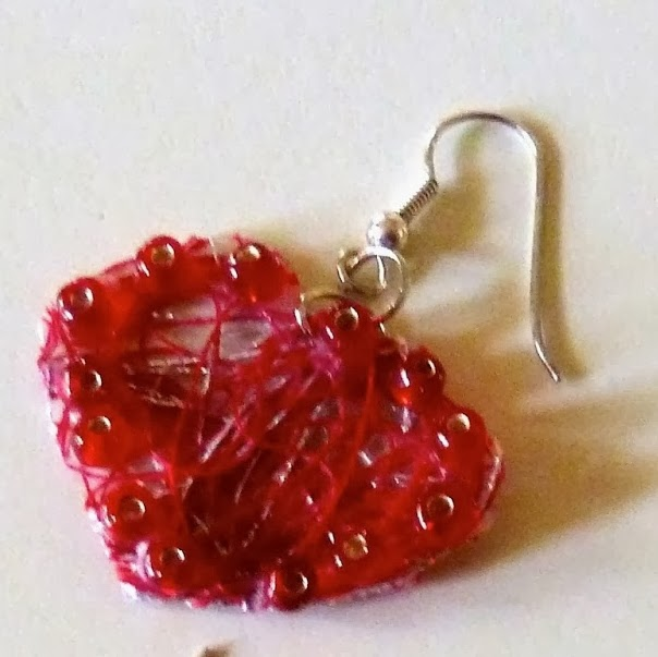 http://www.makeiteasycrafts.com/2014/01/stiffened-thread-valentine-heart.html