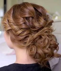Low bridal tousled updo hair style